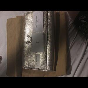 Brand new ysl clutch gold leather nib